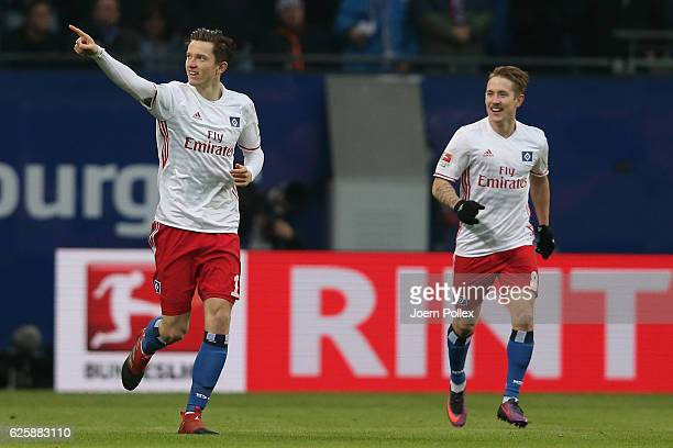 Michael Gregoritsch of Hamburg celebrates after scoring his team's first goal of Hamburg and x of Bremen compete for the ball during the Bundesliga...