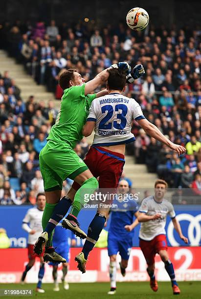 Michael Gregoritsch of Hamburg is challenged by Christian Mathenia of Darmstadt during the Bundesliga match between Hamburger SV and SV Darmstadt 98...