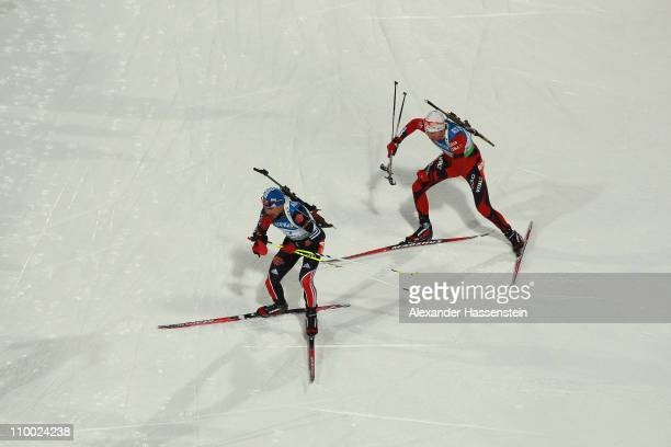 Michael Greis of Germany and Emil Hegle Svendsen of Norway compete in men's mass start during the IBU Biathlon World Championships at A.V. Philipenko...