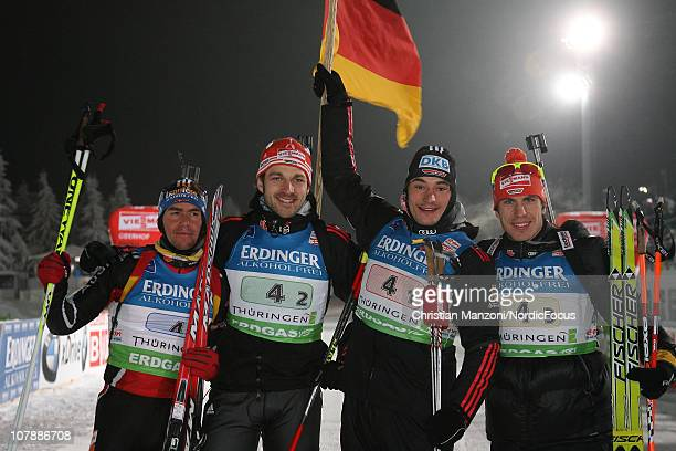 Michael Greis of Germany celebrates the team victory with Alexander Wolf, Christoph Stephan and Arnd Peiffer after the men's relay during the e.on...