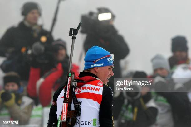 Michael Greis of Germany looks dejected after the Men's 15 km mass start in the e.on Ruhrgas IBU Biathlon World Cup on January 10, 2010 in Oberhof,...