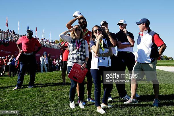 Michael Greller Annie Verret Jordan Spieth and Jimmy Walker of the United States look on from the 18th green after the United States defeated Europe...