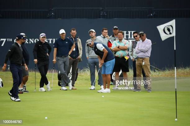 Michael Greller caddie for Jordan Spieth of the United States putts during previews to the 147th Open Championship at Carnoustie Golf Club on July 17...