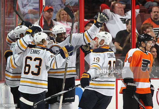 Michael Grier of the Buffalo Sabres celebrates a thirdperiod goal against Kimmo Timonen of the Philadelphia Flyers with teammates Tyler Ennis and Tim...
