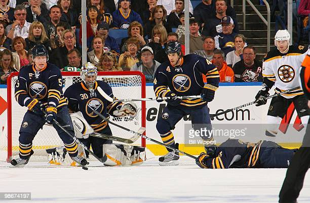 Michael Grier of the Buffalo Sabres gets hit in the head blocking a shot by the Boston Bruins in Game Five of the Eastern Conference Quarterfinals...