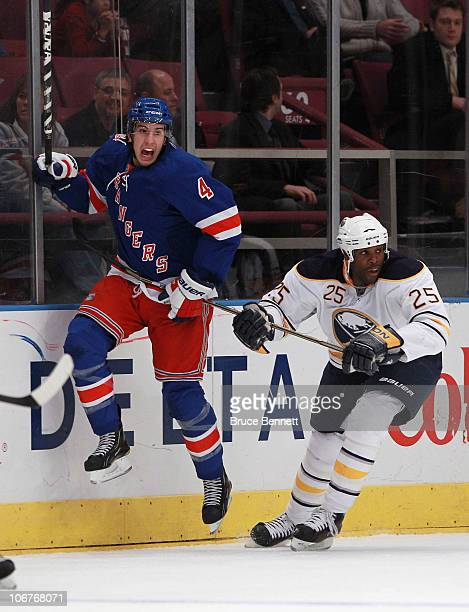 Michael Grier of the Buffalo Sabres holds up Michael Del Zotto of the New York Rangers at Madison Square Garden on November 11 2010 in New York City