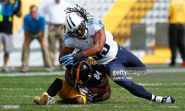 Michael Griffin of the Tennessee Titans hits Antonio Brown of the Pittsburgh Steelers in the second half during the game on September 8 2013 at Heinz...