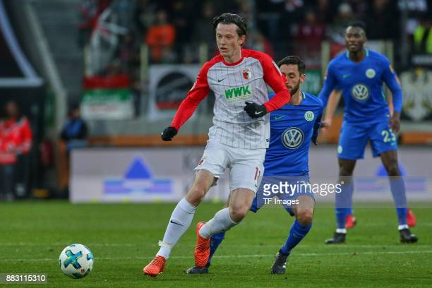 Michael Grogoritsch of Augsburg and Yunus Malli of Wolfsburg battle for the ball during the Bundesliga match between FC Augsburg and VfL Wolfsburg at...