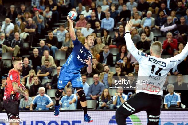 Michael Guigou of Montpellier and Andreas Palicka of Rhein Neckar Lowen during the EHF Champions League match between Montpellier and Rhein Neckar...
