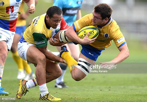 Michael Gunn of Brisbane City is tackled during the round five NRC match between Brisbane City and Sydney Rays at Ballymore Stadium on September 25...