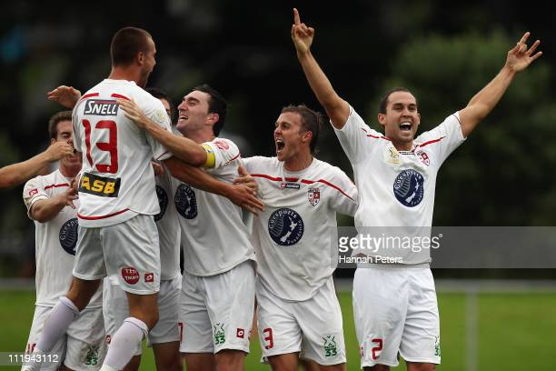 Michael Gwyther, Jake Butler, Aaron Scott and Jason Rowley of Waitakere celebrate with the team after winning the ASB Premiership Final between...
