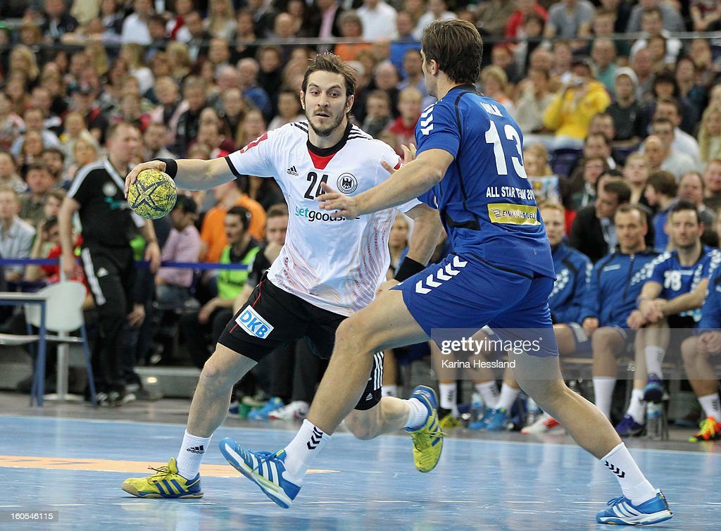 Michael Haass of Germany challenges Marcus Ahlm of Bundesliga All Stars during the match between Germany and Bundesliga All Stars on February 2, 2013 in Leipzig, Germany.