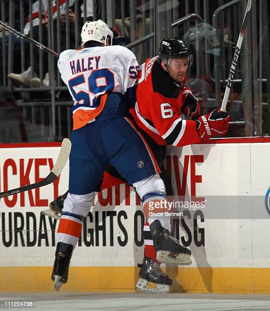 Michael Haley of the New York Islanders boards Andy Greene of the New Jersey Devils at the Prudential Center on March 30 2011 in Newark New Jersey