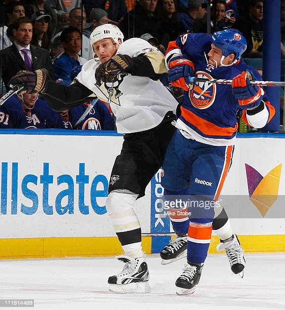 Michael Haley of the New York Islanders collides with Craig Adams of the Pittsburgh Penguins on April 8 2011 at Nassau Coliseum in Uniondale New York