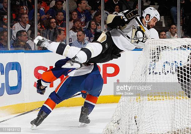 Michael Haley of the New York Islanders takes a two minute penalty for clipping Ben Lovejoy of the Pittsburgh Penguins on April 8 2011 at Nassau...
