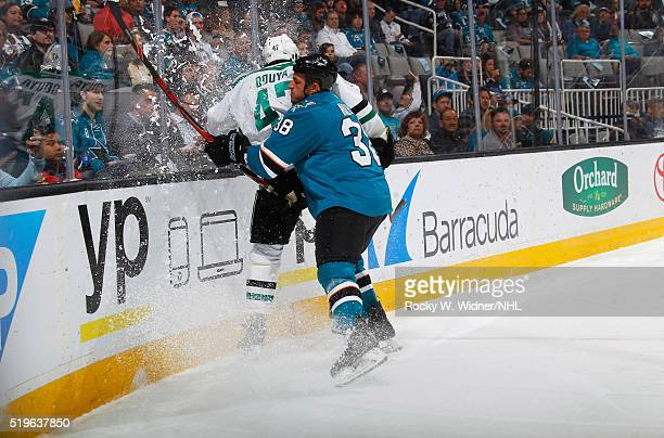 Michael Haley of the San Jose Sharks checks Johnny Oduya of the Dallas Stars into the boards at SAP Center on March 26 2016 in San Jose California