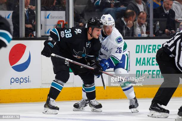 Michael Haley of the San Jose Sharks skates against Joseph Cramarossa of the Vancouver Canucks at SAP Center on March 2 2017 in San Jose California