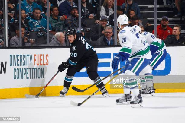 Michael Haley of the San Jose Sharks skates with the puck against Joseph Cramarossa of the Vancouver Canucks at SAP Center on March 2 2017 in San...