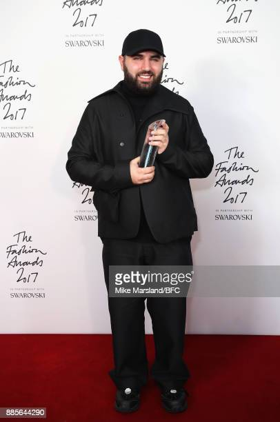 Michael Halpern poses in the winners room wins the British Emerging Talent Womenswear Award during The Fashion Awards 2017 in partnership with...