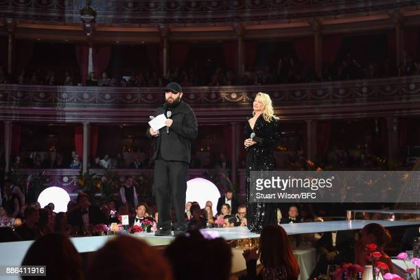 Michael Halpern winner of the British Emerging Talent Womenswear award and Pamela Anderson on stage during The Fashion Awards 2017 in partnership...