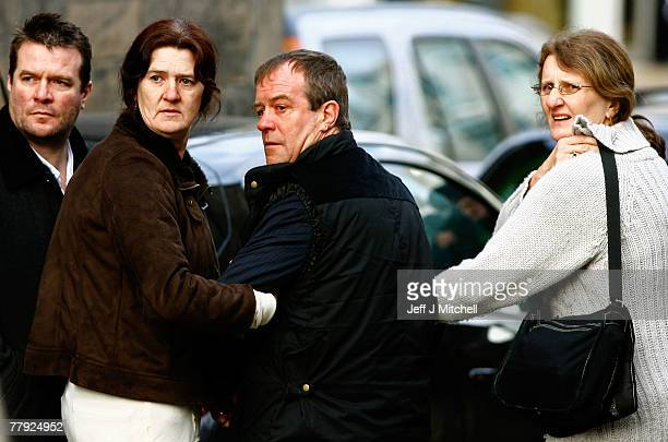 Michael Hamilton the father of Vicky Hamilton is accompanied by family members as Peter Tobin arrives at Linlithgow Sheriff Court November 15 2007 in...
