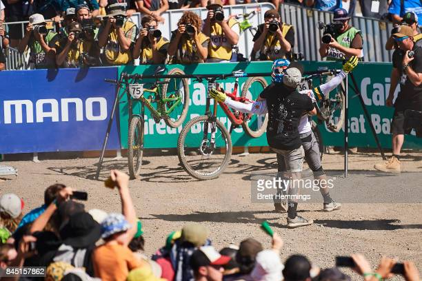 Michael Hannah of Australia celebrates after his run in the Elite Mens Downhill Championship during the 2017 Mountain Bike World Championships on...