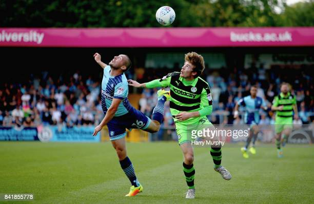 Michael Harriman of Wycombe Wanderers and Luke James of Forest Green Rovers battle for possession during the Sky Bet League Two match between Wycombe...