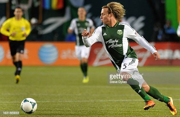 Michael Harrington of Portland Timbers chases down a ball during the second half of the game at JeldWen Field on March 03 2013 in Portland Oregon The...