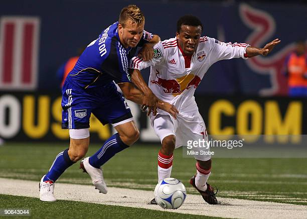 Michael Harrington of the Kansas City Wizards and Dane Richards of the New York Red Bulls battle for control of the ball at Giants Stadium in the...