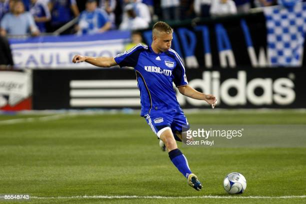 Michael Harrington of the Kansas City Wizards crosses the ball against Toronto FC during the game at Community America Ballpark on March 21 2009 in...