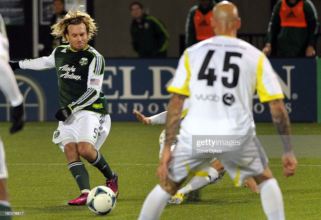 Michael Harrington #5 of the Portland Timbers scores a goal past Daniel Majstorovic #45 of AIK during the second half of the game at Jeld-Wen Field on February 23, 2013 in Portland, Oregon. The game ended in a 1-1 draw.