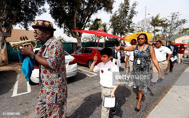 Michael Harris left leads the Second Line/ Processional to the main campus the during a ceremony at Children of Promise Preparatory Academy in...