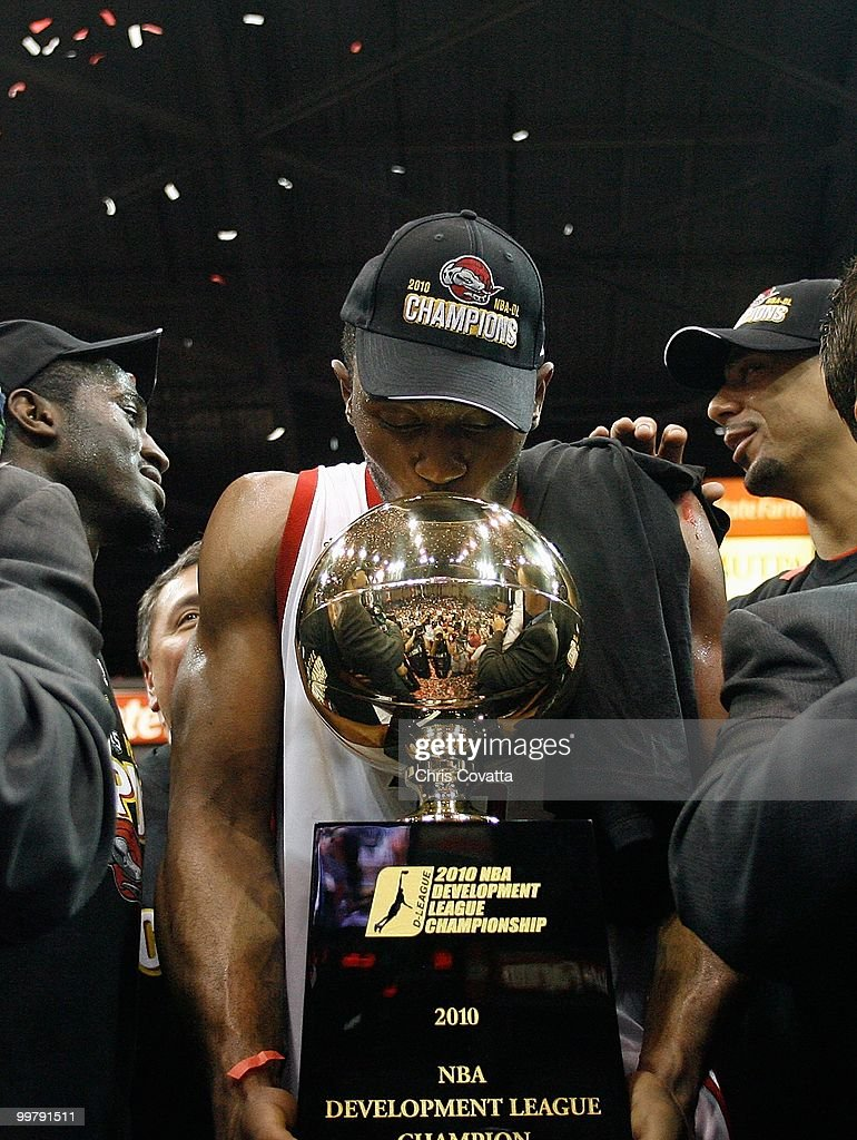 Michael Harris #33 of the Rio Grande Valley Vipers holds the trophy following the victory against theTulsa 66ers in Game Two of the 2010 NBA D-League Finals at the State Farm Arena on April 27, 2010 in Hidalgo, Texas. The Valley Vipers won 94-91 to claim the D-League Championship.