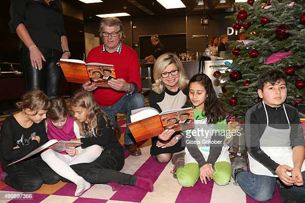 Michael Hartl and Marianne Hartl sing christmas songs with children during the World Childhood Foundation Baking at Hotel Vier Jahreszeiten on...