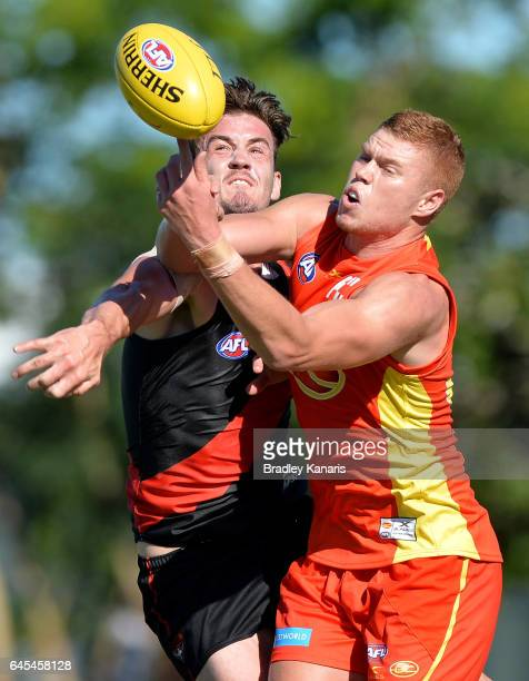 Michael Hartley of the Bombers and Peter Wright of the Suns challenge for the ball during the JLT Community Series AFL match between the Gold Coast...