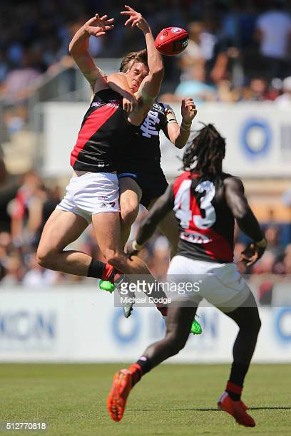 Michael Hartley of the Bombers is colected high by Daniel Gorringe of the Blues during the 2016 AFL NAB Challenge match between Carlton and Essendon...