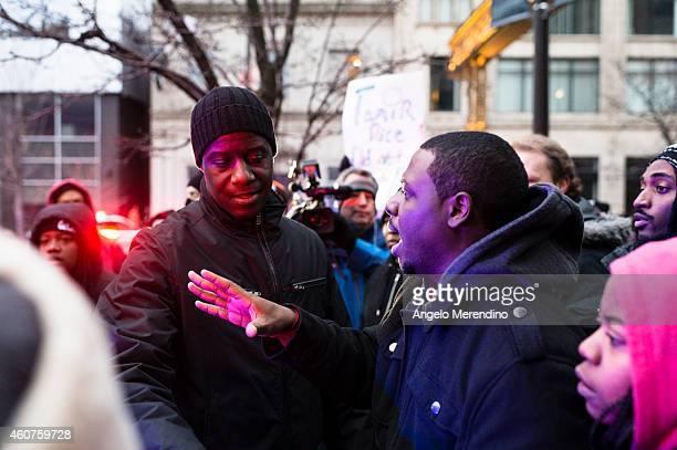 Michael Hassell of Ferguson Missouri speaks with Cleveland Chief of Police Calvin Williams at the corner of Huron and Prospect December 21 in...