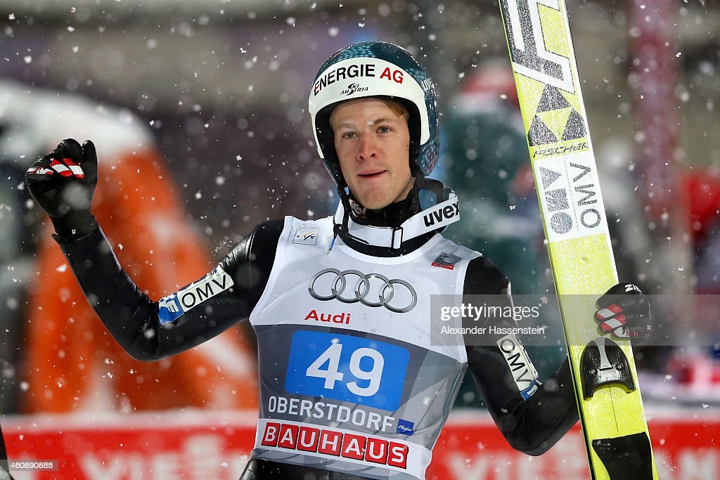 Michael Hayboeck of Austria celebrates after his final jump on day 2 of the Four Hills Tournament Ski Jumping event at Schattenberg-Schanze Erdinger Arena on December 29, 2014 in Oberstdorf, Germany.