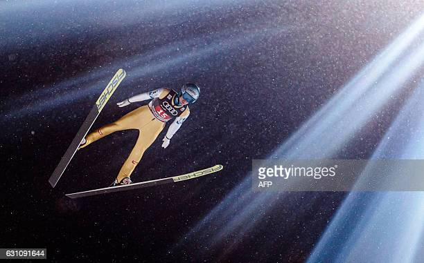 Michael Hayboeck of Austria competes during the ski jumping event in Bischofshofen which is the fourth station of the FourHills Ski Jumping...