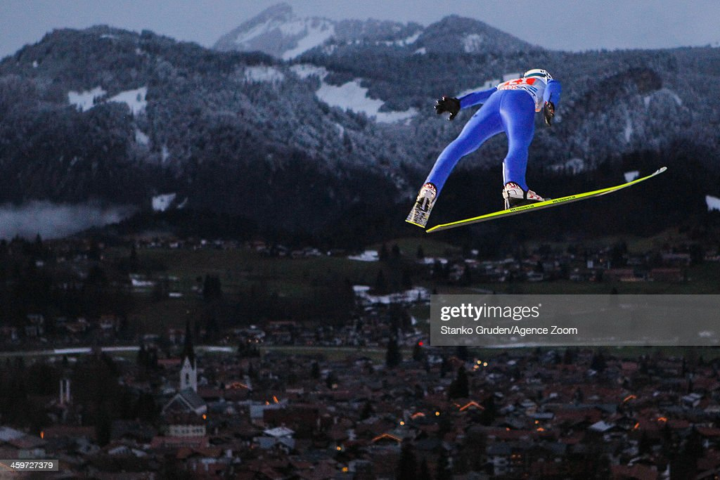 Michael Hayboeck of Austria in action during the FIS Ski Jumping World Cup Vierschanzentournee (Four Hills Tournament) on December 29, 2013 in Oberstdorf, Germany.