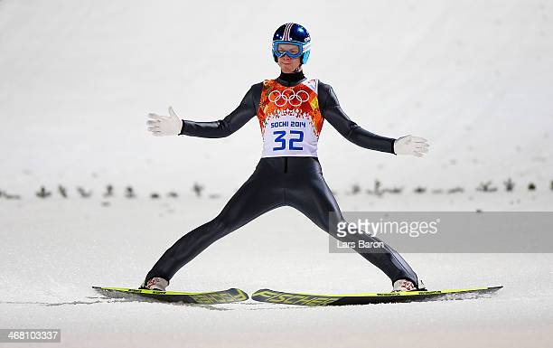 Michael Hayboeck of Austria lands his jump during the Men's Normal Hill Individual first round on day 2 of the Sochi 2014 Winter Olympics at the...