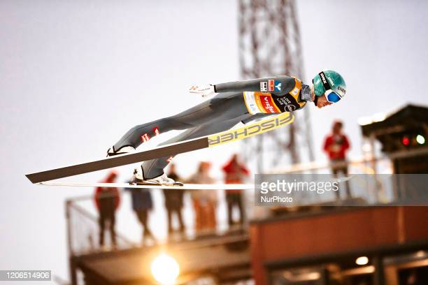 Michael Hayboeck soars in the air during the men's large hill team competition HS130 of the FIS Ski Jumping World Cup in Lahti, Finland, on February...