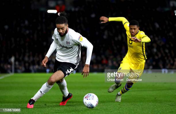 Michael Hector of Fulham FC and Rhian Brewster of Swansea City in action during the Sky Bet Championship match between Fulham and Swansea City at...