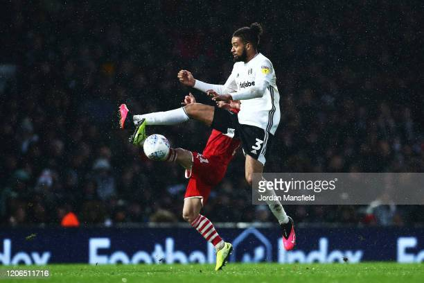 Michael Hector of Fulham tackles in the air with Conor Chaplin during the Sky Bet Championship match between Fulham and Barnsley at Craven Cottage on...