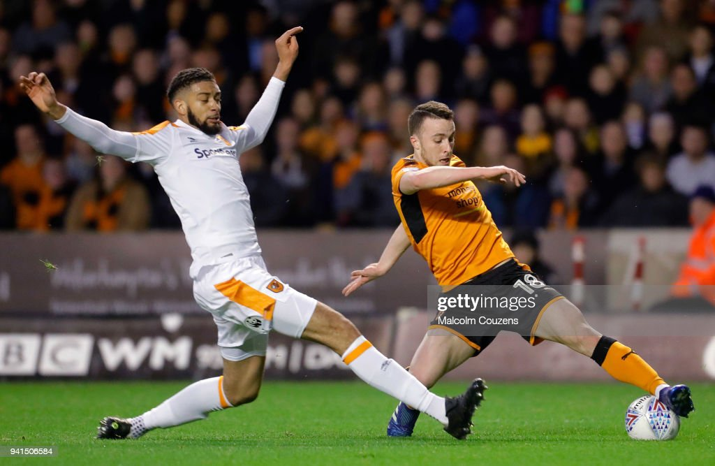 Michael Hector of Hull City concedes a penalty with a foul on Dogo Jota of Wolverhampton Wanderers during the Sky Bet Championship match between Wolverhampton Wanderers and Hull City at Molineux on April 3, 2018 in Wolverhampton, England.