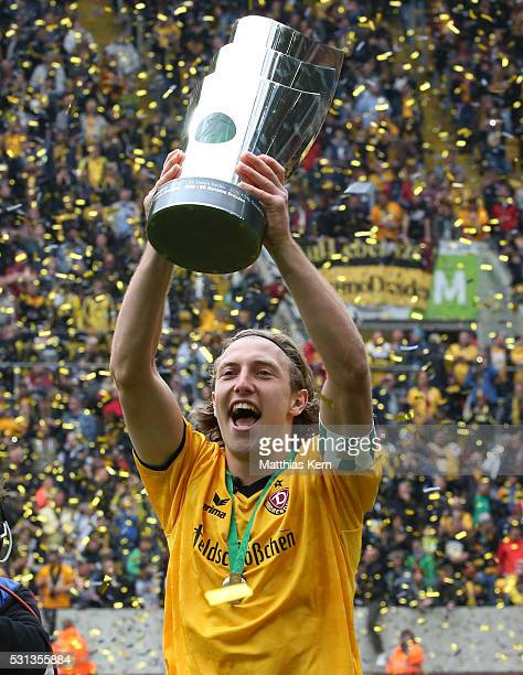 Michael Hefele of Dresden celebrates with the trophy after the third league match between SG Dynamo Dresden and SG Sonnenhof Grossaspach at DDV...