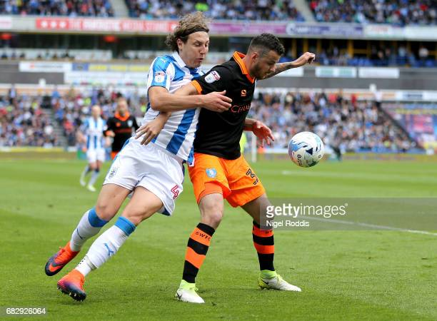 Michael Hefele of Huddersfield Town and Daniel Pudil of Sheffield Wednesday battle for possession during the Sky Bet Championship Play Off Semi Final...