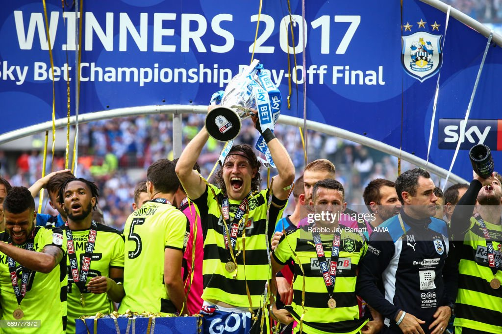Michael Hefele of Huddersfield Town lifts the Sky Bet Play Off Final trophy during the Sky Bet Championship Play Off Final match between Reading and Huddersfield Town at Wembley Stadium on May 29, 2017 in London, England.