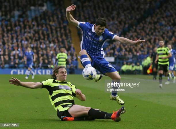 Michael Hefele of Huddersfield Town tackles Fernando Forestieri of Sheffield Wednesday during the Sky Bet Championship play off semi final second leg...