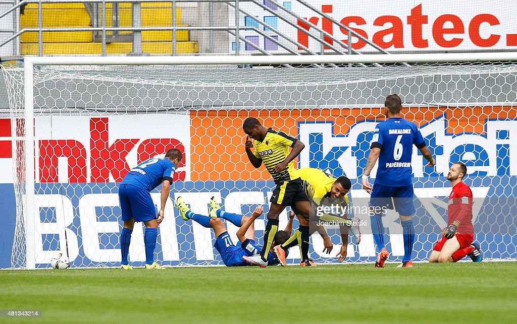 Michael Heinloth, Niklas Hoheneder, Marvin Bakalorz and Lukas Kruse of Paderborn challenges Odion Ighalo and Troy Deeney of Watford celebrate their second during the pre-season friendly match between SC Paderborn and Watford FC at Benteler Arena on July 19, 2015 in Paderborn, Germany.
